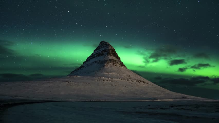 Slow tilt up, showing aurora Borealis at Mt. Kirkjufell in Iceland, Timelapse. | Shutterstock HD Video #1027635170
