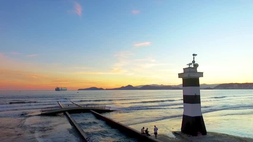 Drone shot Santos Brazil beach lighthouse sunset