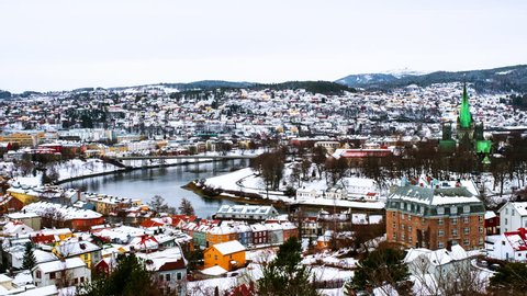 Trondheim, Norway. Aerial view of the city center in winter in Trondheim, Norway with snow. Time-lapse of river and historical colorful buildings