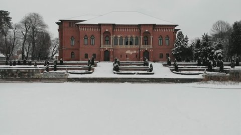 Aerial drone panoramic view over Mogosoaia Palace frozen lake during winter Bucharest, Romania