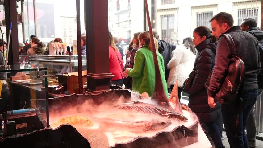 MADRID, SPAIN - MARCH 31, 2019: Sea Food frozen Fish on San Miguel Market Mercado in Madrid, Spain #1027769060