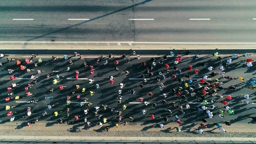 Marathon running on the road. Top view shot