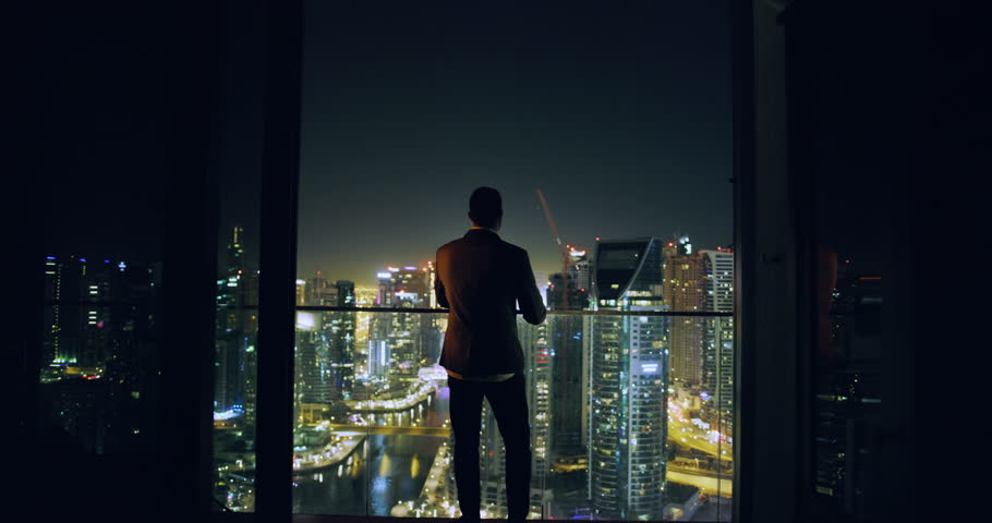Young Entrepreneur Walkling Toward City Sky Scrapers Dubai Urban Panorama Futuristic Digital Nomad Night Downtown Slow Motion Red Epic 8k #1027882880