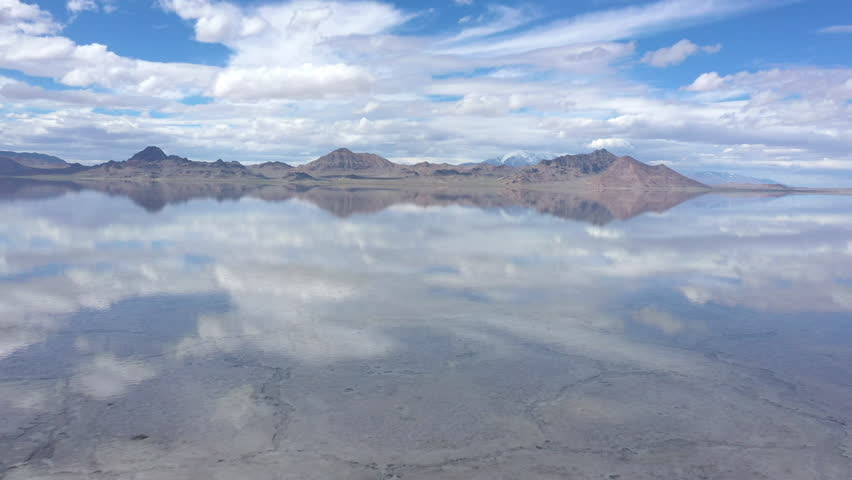 Reflection of clouds in water over the Bonneville Salt Flats viewing the crack formations in the salt bed underneath.