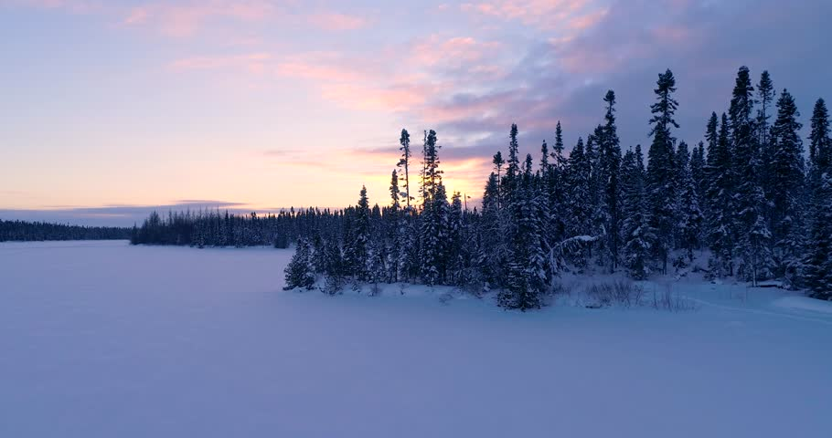A Canadian frozen lake during sunrise.