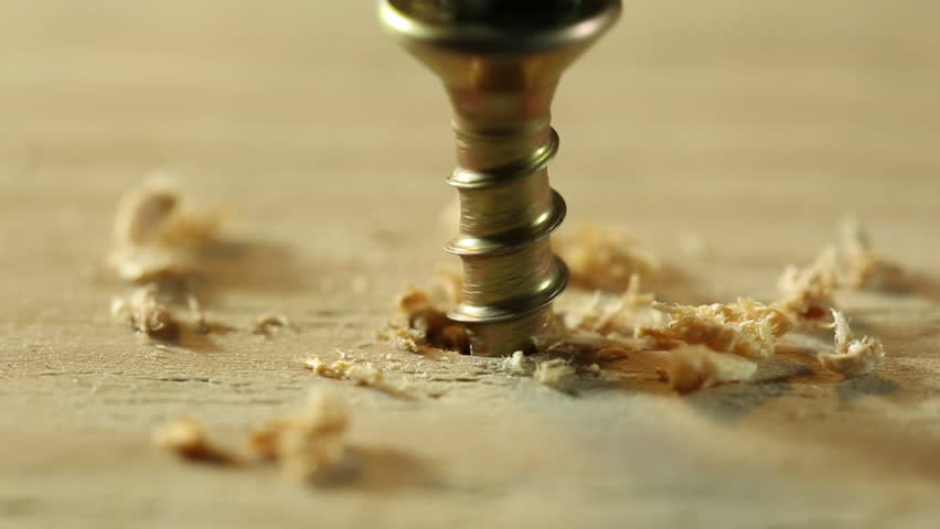 Extreme close up of drilling into wood with screw twisted into place. | Shutterstock HD Video #1027969880