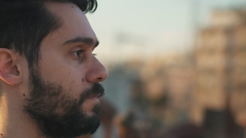 Cinematic Shot of Young Man, Camera follows around him, On Rooftop of a building, Flares before Sunset, Slow Motion Shot with Gimbal | Shutterstock HD Video #1028040020