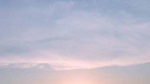 Time lapse nature background. Sunset time interval. The movement of clouds and Sun.
