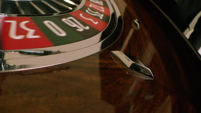 Roulette with rolling ball in slow motion | Shutterstock HD Video #1028099780