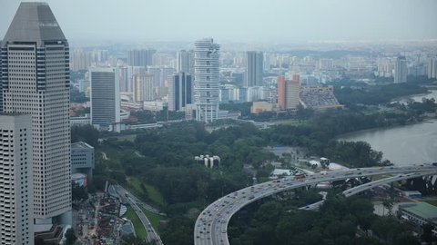 Time Lapse Aerial View of Singapore City Skyline Car Traffic on Busy Highway Day