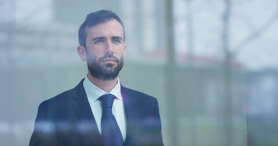 Slow motion of handsome businessman using futuristic augmented reality hologram for viewing finance and economic trends. | Shutterstock HD Video #1028140610