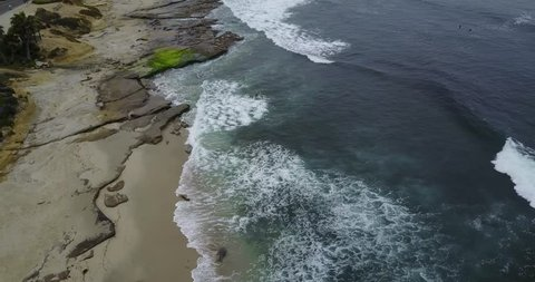 Aerial view of rocky coastline and ocean waves on the United States West Coast at La Jolla, San Diego