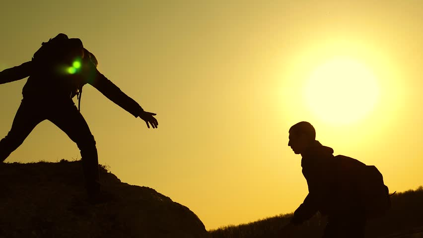 Climbers silhouettes stretch their hands to each other, climbing to top of hill. teamwork of business people. travelers climb one after another on rock. joint business. Slow motion | Shutterstock HD Video #1028195180
