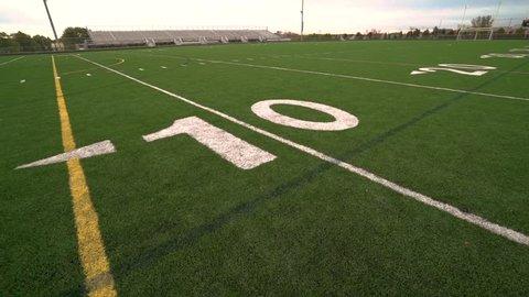 A panning shot of a high school American Football stadium.