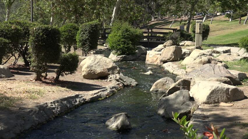 A peaceful stream in a park | Shutterstock HD Video #1028205590