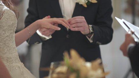 wedding couple exchange rings close up