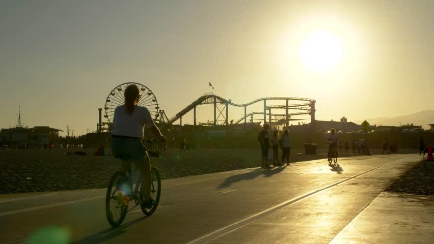 Los Angeles, California / USA - June 3, 2016: Tourists on Santa Monica Bike Path at Sunset, Los Angeles Beach #1028243390