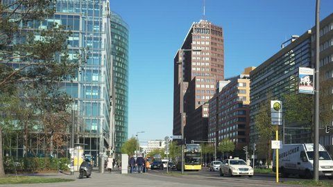 BERLIN, GERMANY - APRIL 15, 2019: Traffic With Yellow BVG Bus Near Potsdamer Platz In Berlin, Germany In Spring, Skyscrapers In The Background