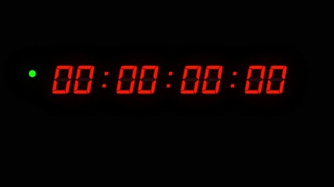 One minute of glowing led 24 fps timecode readout with red digits and green blinking dot on black background.