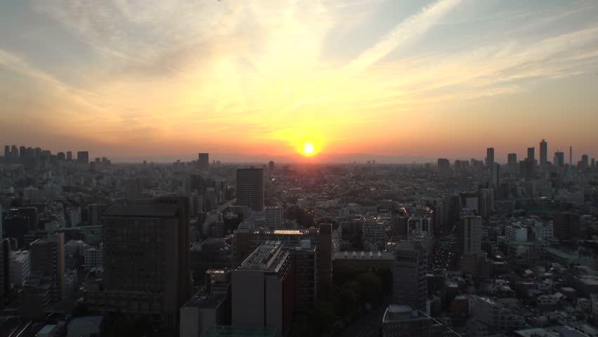 TOKYO,  JAPAN - CIRCA APRIL 2019 : Aerial sunset view of CITYSCAPE of TOKYO around Shinjuku city and Ikebukuro city.  View from Bunkyo ward.