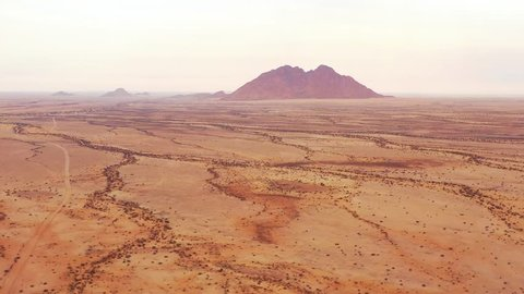 SPITZKOPPE, NAMIBIA - CIRCA 2018 - Aerial over the Namib Desert and the massive rock formations at Spitzkoppe, Namibia.