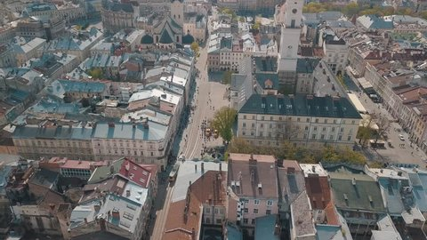 Aerial Roofs and streets Old City Lviv, Ukraine. Central part of old city. European City in spring. Densely populated areas of the city. Panorama of the ancient town. Town Hall, Ratush. Drone shot