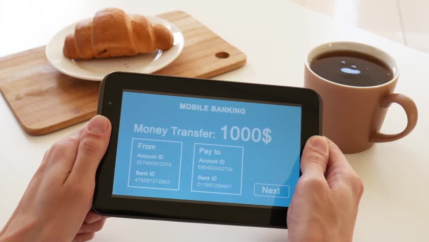 A person makes a transfer using the Internet bank on his tablet. POV view. Blue custom interface design. The interface is not real. Information fictional. | Shutterstock HD Video #1028362760