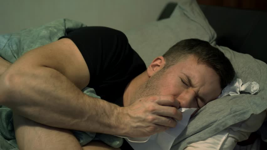 Unwell Man Coughing In Bed, Looking Miserable Off Work Sick, 4K. | Shutterstock HD Video #1028365370
