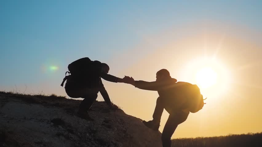 teamwork help business travel silhouette concept. group of tourists lends a helping hand climb the cliffs mountains lifestyle . people climbers climb to the top overcoming hardships the path to #1028438570