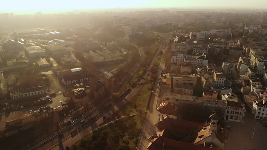 Lift drone of the Old Town of Constanta, Romania, Europe, shot in spring during sunset and Golden Hour, revealing the architecture and traffic while seagulls fly | Shutterstock HD Video #1028470820