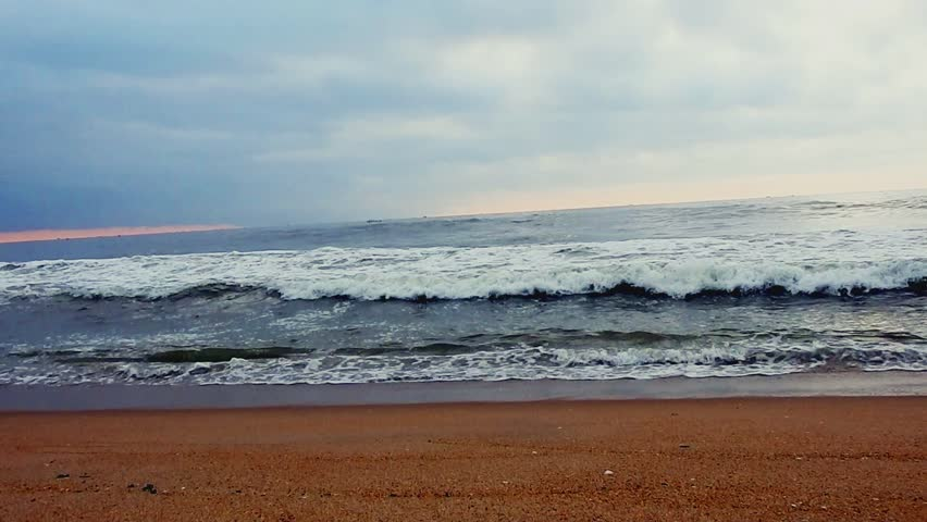 Waves on the seashore at sunset  Beautiful waves… - Royalty Free Video