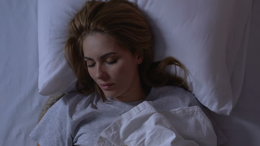 Beautiful lady lying in bed at night, cozy healthy sleep on comfortable mattress | Shutterstock HD Video #1028591870