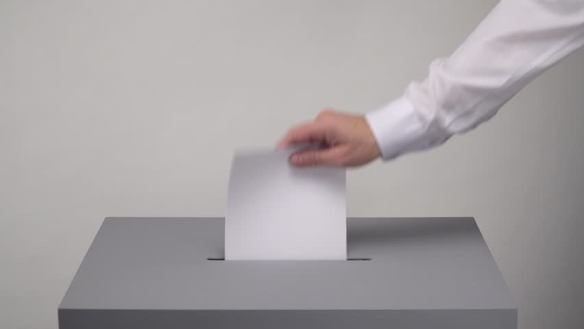 Gray ballot box. Presidential and parliamentary elections. The voter throws the ballot into the ballot box. | Shutterstock HD Video #1028594960