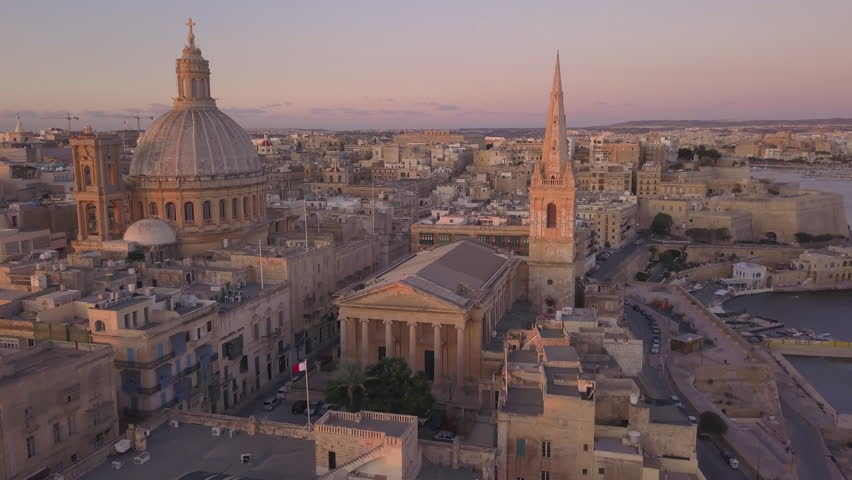 25P dawn flying towards and around iconic Carmelite church dome and steeple in Valletta Malta | Shutterstock HD Video #1028626700
