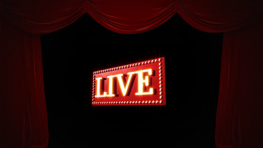 Digital animation of the word LIVE on a moving red rectangular platform surrounded with light bulbs on a black background with draping curtains