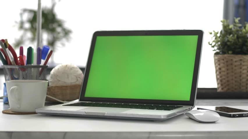 Desk working at home on with laptop green screen #1028646650