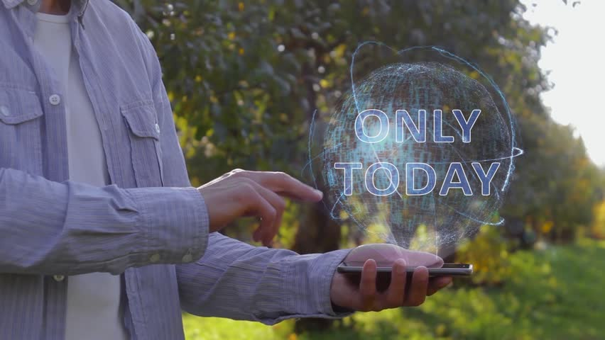 Unrecognizable man shows conceptual hologram with text Only today. Farmer on the background of the apple orchard in casual clothes with the technology of the future mobile screen