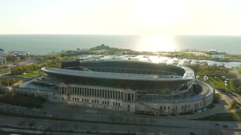 Chicago, Illinois / USA - April 28, 2019: Dolly In to Soldier Field - Home of the Chicago Bears along busy Lake Shore Drive. [Editorial] This beautiful aerial footage was taken by Bert