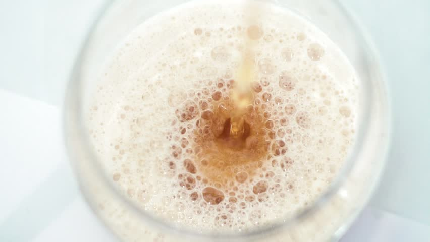 Slow Motion shot of Serving Beer in a glass #1028859680