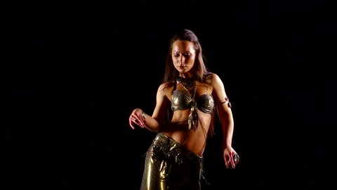 Dancer black background belly Dance. Beautiful belly dancer dancing ethnic dances in sexy traditional dress