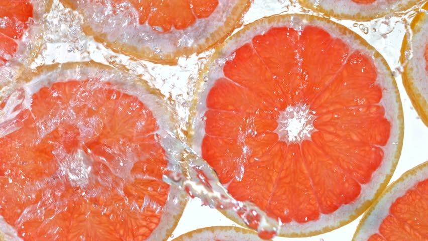 Super Slow Motion Shot of Splashing Water to Grapefruit Slices at 1000fps.