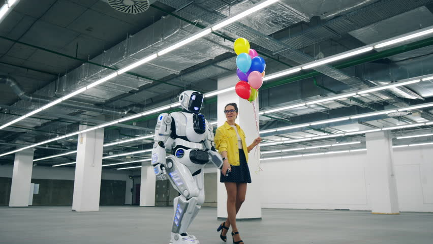 Spacious hall with a woman and a robot walking together | Shutterstock HD Video #1028988320