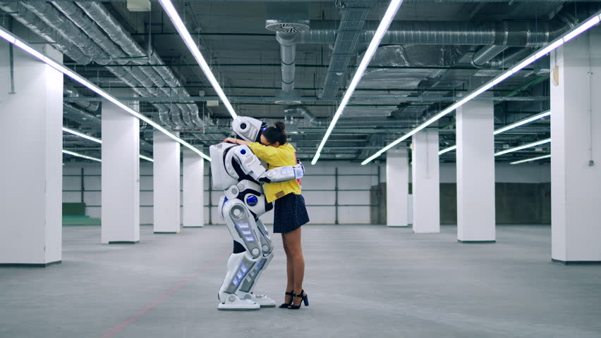 Embraces of a lady and a human-like cyborg | Shutterstock HD Video #1028988530