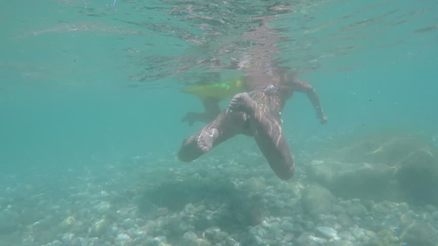 Underwater view, kid swimming in the sea, clear water. Child swiming with mum #1029018950