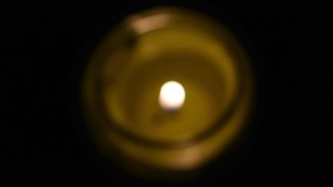 blurry lit candle will sharp image