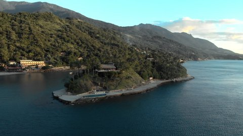Aerial: Private Island Architecture in Archipelago With Lush Jungle in the Background in Ilhabela, Brazil