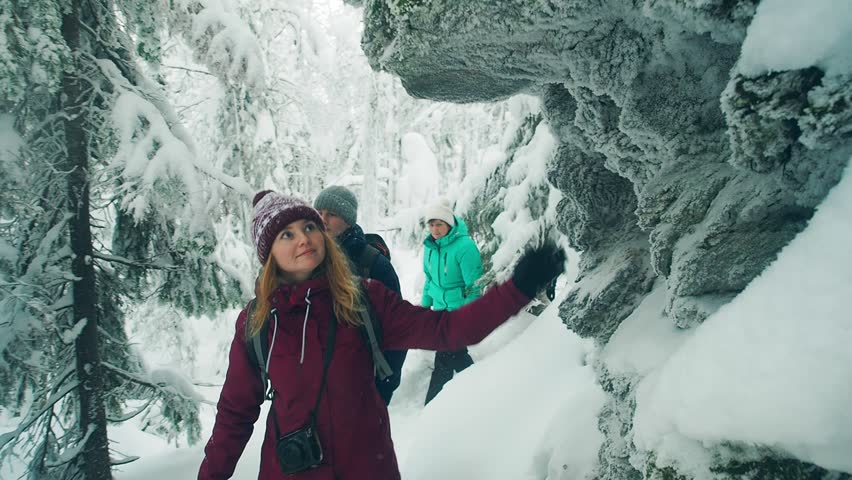 Family hiking in winter forest, beautiful snow landscape. Travel together concept: senior parents trekking with their children during winter vacation. Hikers People  backpackers walk winter landscape