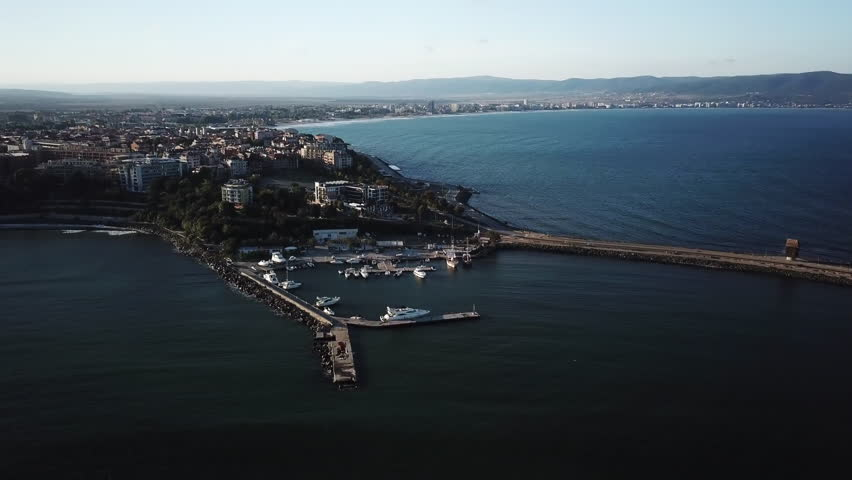 Top view aerial of Nessebar city on the Black Sea coast of Bulgaria, new part and a bridge leading to the old city