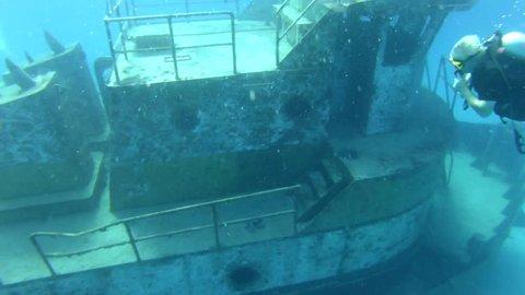 Scuba Diver Exploring Boat Wreck in Nassau