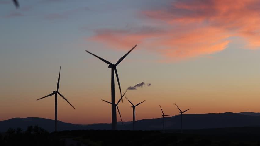 Wind turbine generator wind energy plant power turbine. Wind power renewable electric energy production. Wind energy nature clean fields blue sky alternative energy sunset clouds background.